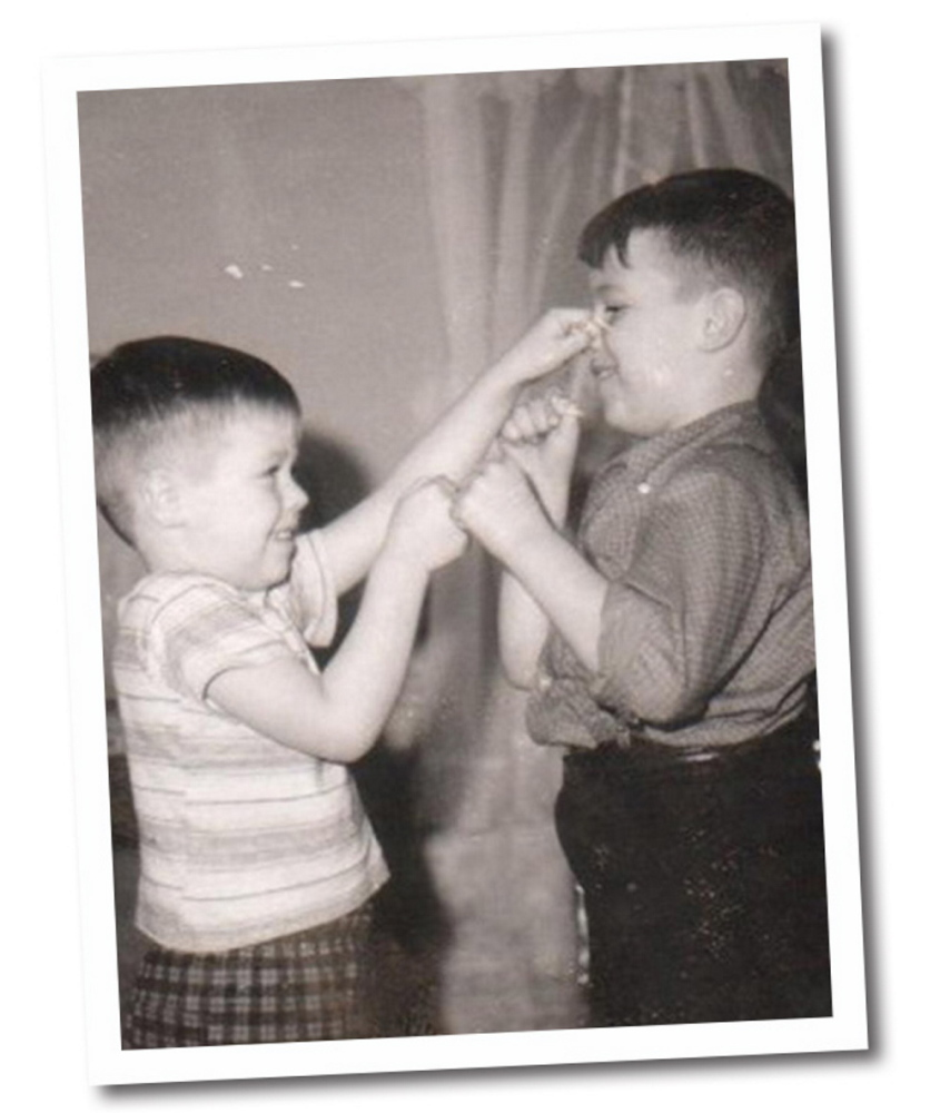 Mike Michaud, left, pinches his brother Jim's nose duirng a boxing match when they were boys growing up in Medway. Family photo
