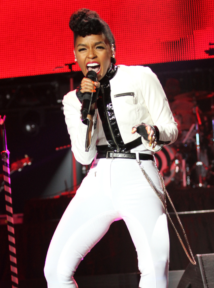 "Janelle Monae performs at the 20th celebration of the Essence Festival in the Superdome in New Orleans. She covered Prince's ""Let's Go Crazy."""