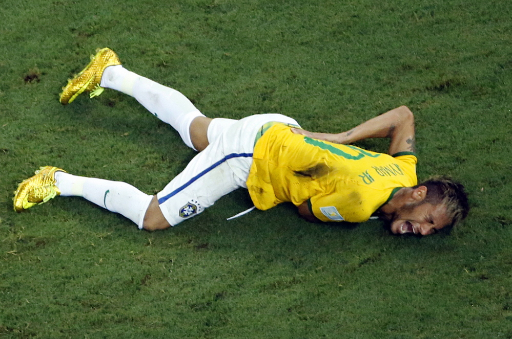 Brazil's Neymar grimaces in pain during the World Cup quarterfinal soccer match between Brazil and Colombia at the Arena Castelao in Fortaleza, Brazil, Friday.