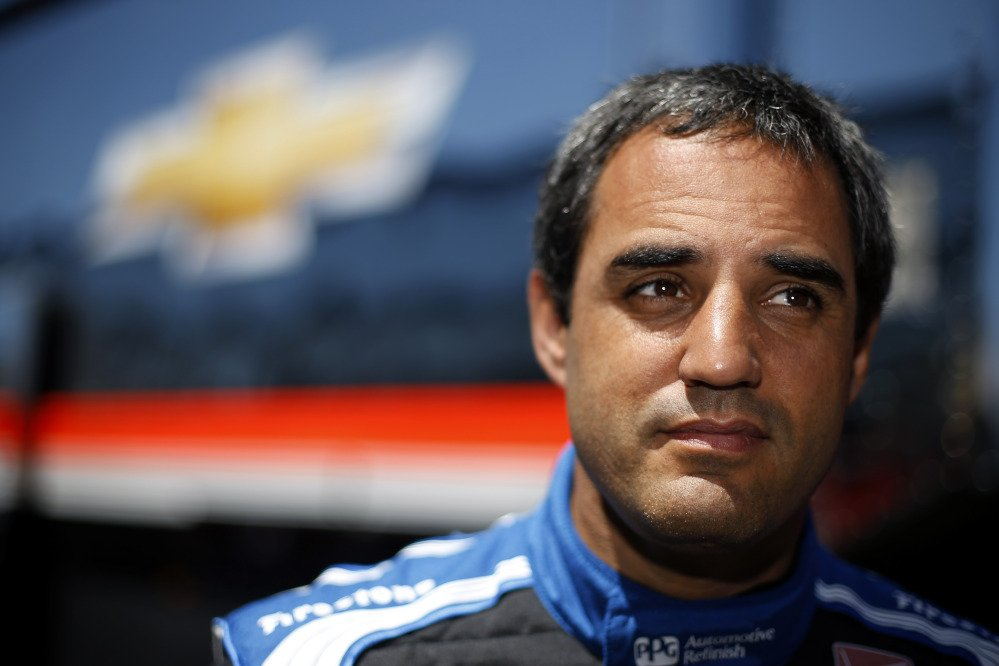 IndyCar driver Juan Pablo Montoya, of Colombia, listens to a reporter's question during an interview after a practice session for Sunday's Pocono IndyCar 500 auto race, Saturday.