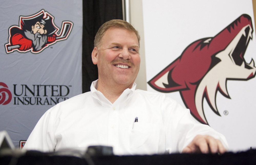 "Portland Pirates' majority owner Ron Cain attends a news conference in May. His business sense and love of the game were honed at a young age. ""I played a lot of team sports, but hockey is more near and dear because the coaches have more of a direct impact on the kids,"" he said. ""At least, that's my perception."" Carl D. Walsh/Staff Photographer"