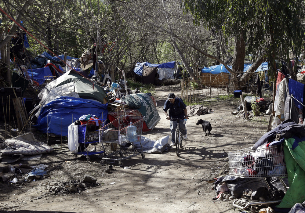 Tents are set up along a pathway in the Jungle, a homeless encampment in San Jose, Calif. Residents of the Jungle are well aware of the affluent world that lies just outside its borders in Silicon Valley, which is home to Apple, Google, Facebook and more tech giants.