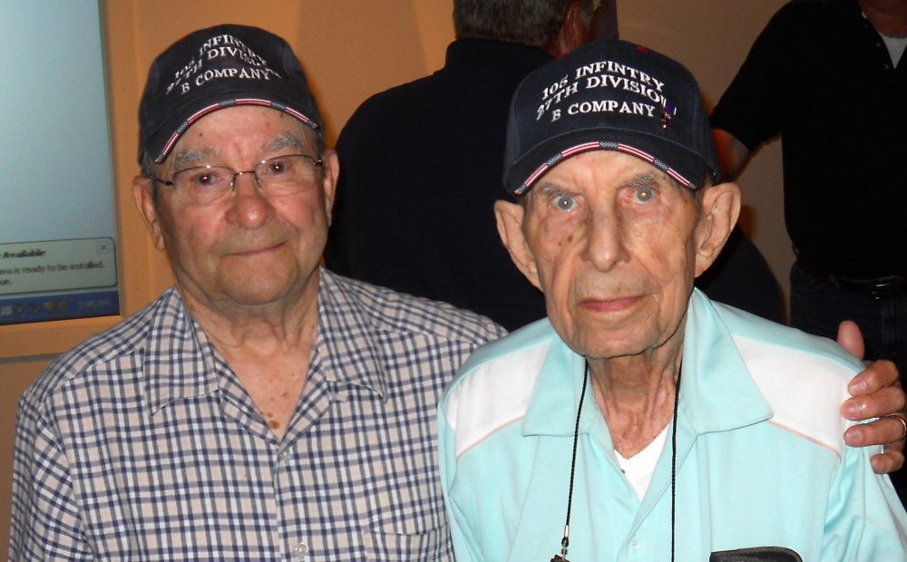 "Age won't make Wilfred ""Spike"" Mailloux, left, forget his debt to John Sidur, who came to his aid amidst the fierce fighting between U.S. and Japanese forces on the strategically critical island of Saipan. Mailloux and Sidur attended the 70th anniversary of the battle at the New York State Military Museum on June 7."