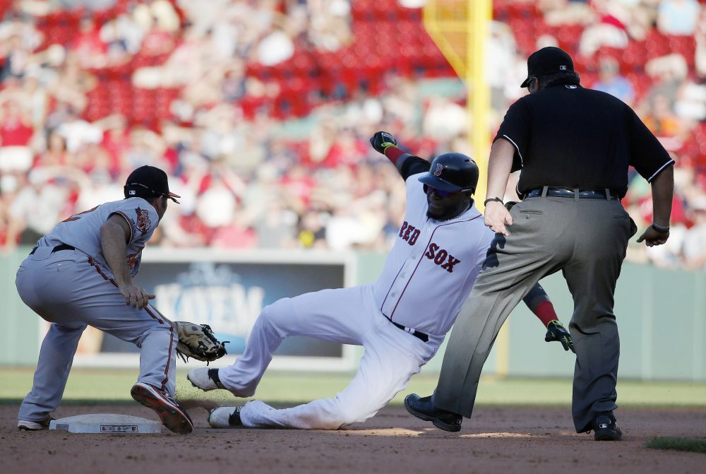 Baltimore Orioles' J.J. Hardy, left, tags Boston Red Sox's David Ortiz, right, at second base after Oritz tried to reach on a single in the twelfth inning of a baseball game in Boston, Sunday.