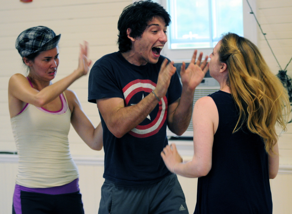 "Erica Murphy (Rosalind), left, Leighton Samuels (Oliver) and Lindsay Tornquist (Celia) rehearse a scene from ""As You Like It"" in the Helen Melledy Grange in Monmouth."