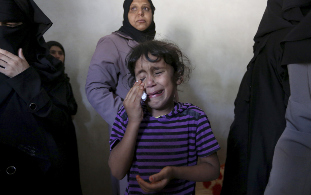 Asma weeps at the funeral of her brother, Gomha Abu Shalouf, 27, a member of the Ezz Al-Din Al Qassam Brigades, the military wing of Hamas, who was killed in an airstrike in Rafah, southern Gaza Strip on Monday as violence in the region escalates.