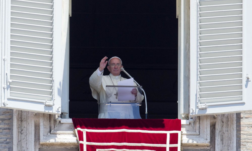 Pope Francis celebrates the Angelus noon prayer from his studio window overlooking St. Peter's square, at the Vatican, Sunday.