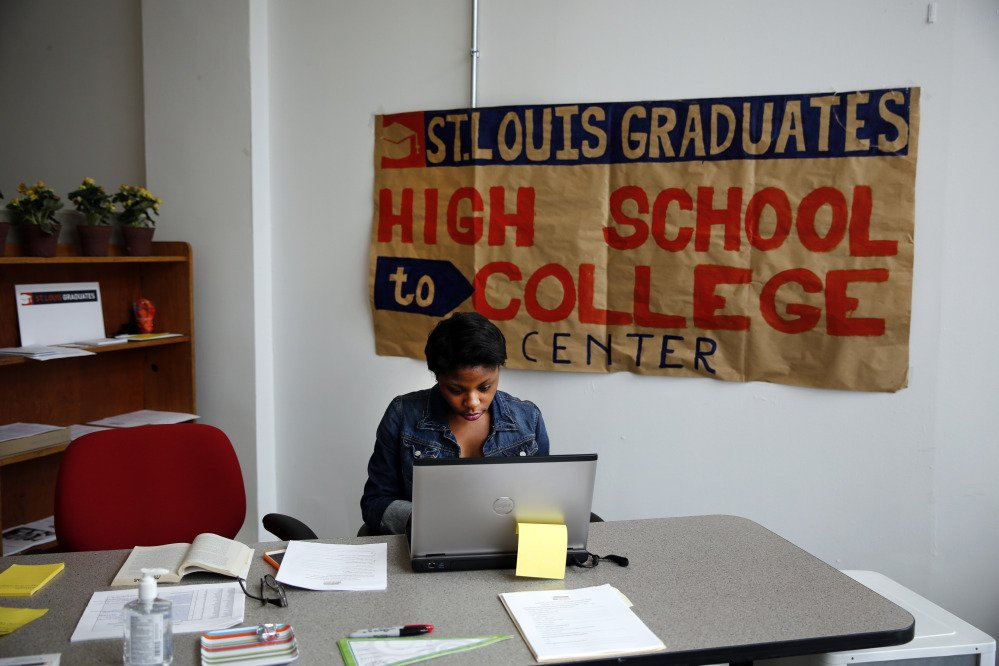 Intern Daisha Tanking working at the St. Louis High School to College Center in St. Louis. A drop-in counseling center akin to a pop-up retail store, the center helps low-income students make the transition to college by negotiating financial aid agreements, housing contracts and the other myriad details of college enrollment.
