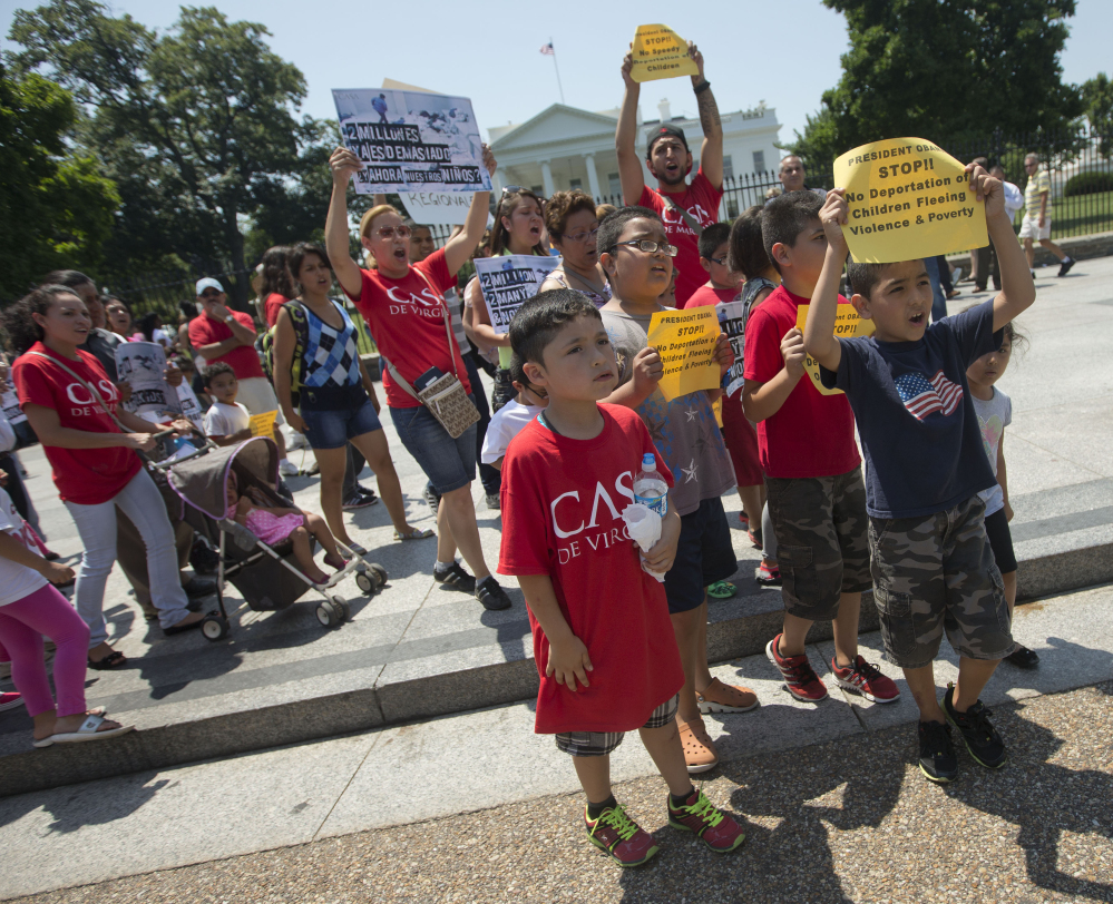 Demonstrators march in front of the White House on Monday after a news conference with immigrant families and children's advocates responding to President Obama's response to the crisis of unaccompanied children and families illegally entering the U.S.