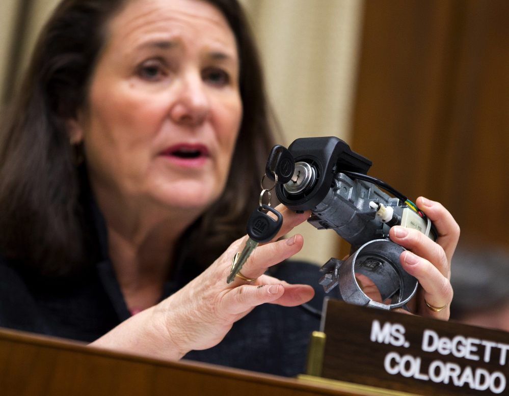 U.S. Rep. Diana DeGette, D-Colo., ranking member of the House Oversight and Investigations subcommittee, holds up a GM ignition switch while she questions General Motors CEO Mary Barra on Capitol Hill in Washington on April 1.
