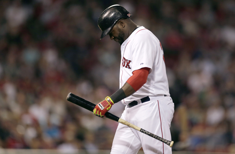 Red Sox designated hitter David Ortiz heads to the dugout after grounding out during the seventh inning Monday.