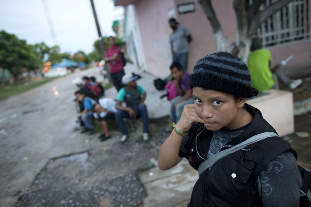 A 14-year-old Guatemalan girl traveling alone in June waits for a northbound freight train along with other Central American migrants in Arriaga, Chiapas state, Mexico.