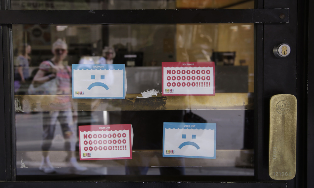 """A Crumbs cupcake shop sits empty on Federal Street in Boston on Tuesday. """" A cupcake shop today can't survive just on cupcakes,"""" an analyst says. Companies that rely on a single product suffer when customers are fickle."""