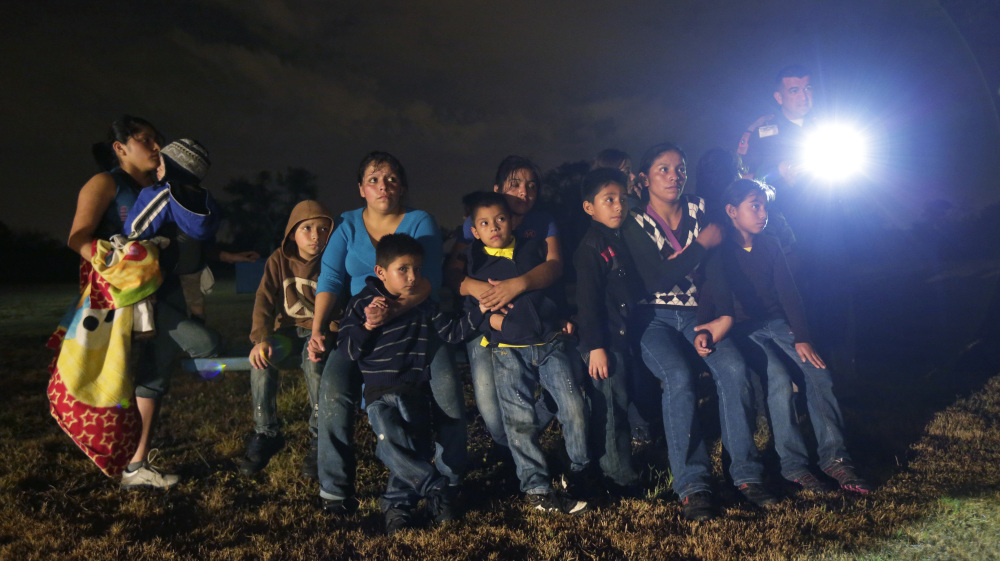 A group of immigrants from Honduras and El Salvador who crossed the U.S.-Mexico border illegally are stopped in Granjeno, Texas, last month. In the first week of June alone, agents arrested more than 2,800 people in this area.