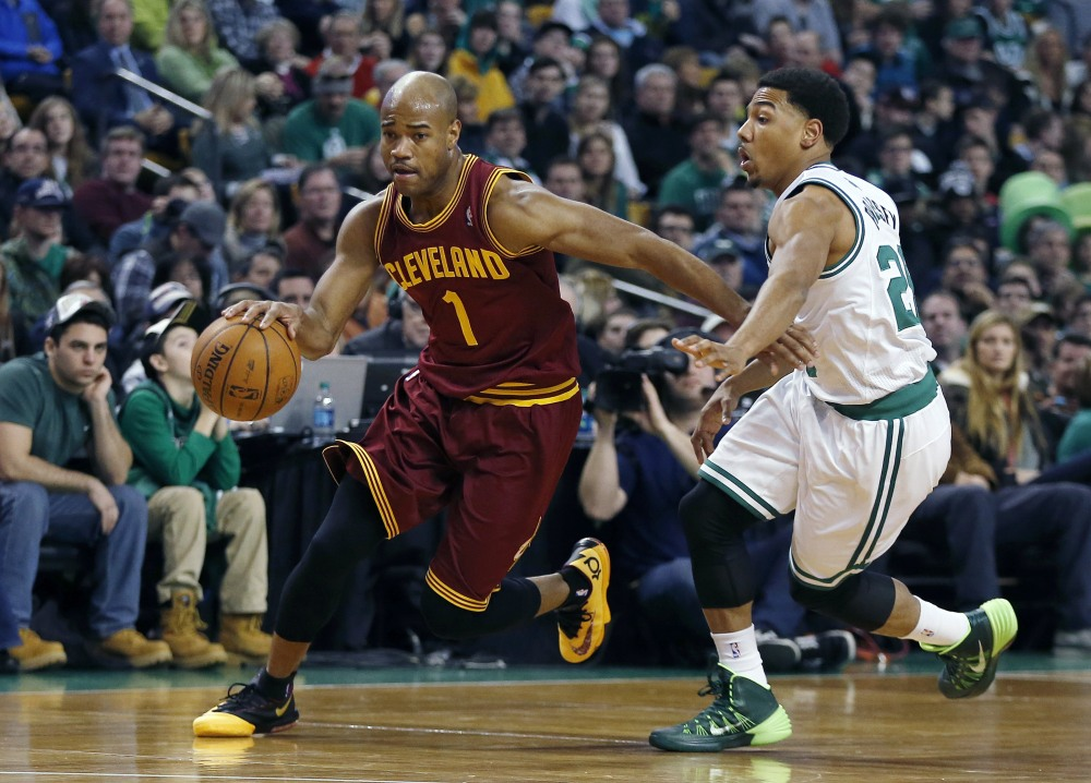 In this Dec. 28, 2013 file photo, Cleveland Cavaliers' Jarrett Jack (1) drives past Boston Celtics' Phil Pressey (26) in the second quarter of an NBA basketball game in Boston.