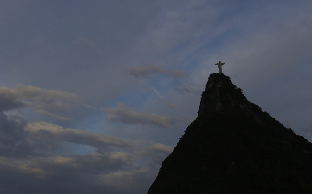 Christ the Redeemer statue is silhouetted against the sky as Wednesday dawned in Rio de Janeiro, Brazil, a day after the national soccer team's brutal and humiliating 7-1 World Cup defeat to Germany.
