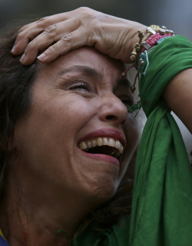 A Brazil soccer fan cries as she watches Germany defeat her team in a World Cup semifinal match, via a live telecast in Belo Horizonte, Brazil, Tuesday.