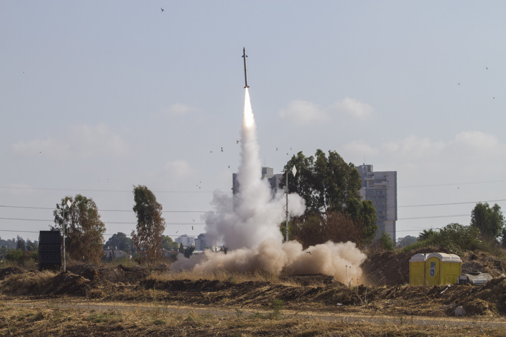 An Iron Dome air defense system fires to intercept a rocket from the Gaza Strip in Tel Aviv, Israel, on Wednesday.