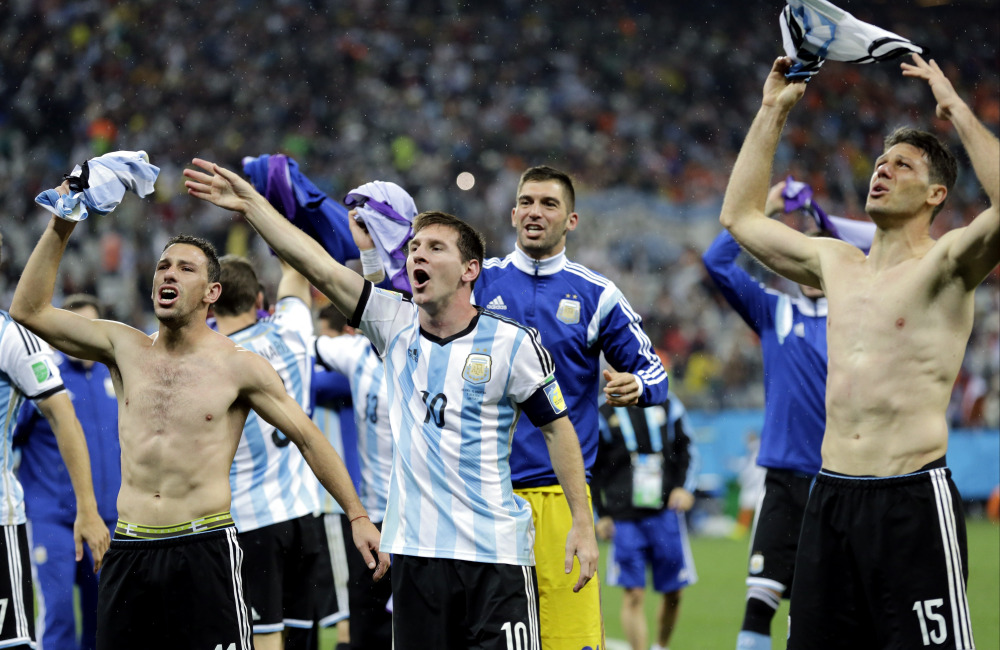 Argentina's Lionel Messi (10) celebrates with this teammates after Argentina defeated the Netherlands 4-2 in a penalty shootout after extra time to advance to the finals during the World Cup semifinal soccer match in Sao Paulo Brazil on Wednesday.