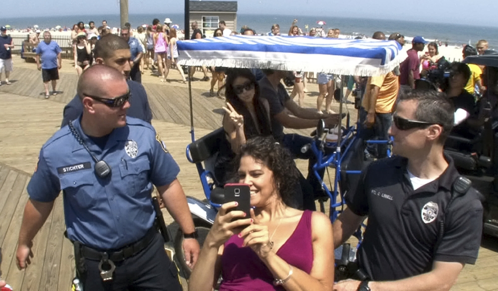 Sabryna Alvarez of Eatontown, N.J., grabs a selfie Tuesday with Kim Kardashian and her friend and publicist Jonathan Cheban on the boardwalk in Seaside Heights, N.J.