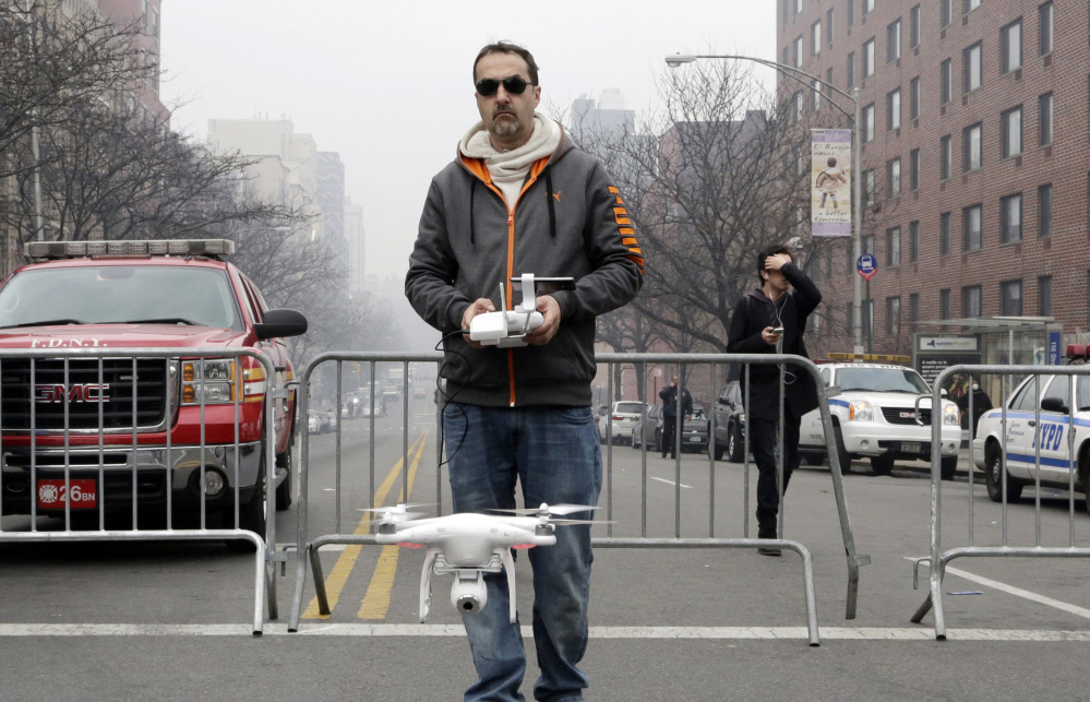 Brian Wilson launches a small drone equipped with a video camera to fly over the scene of an explosion in March that leveled two apartment buildings in East Harlem.