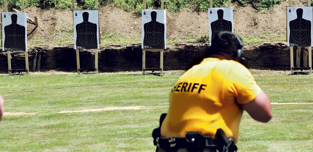 Chris Donahue, brother of the late Chief Deputy Shawn Donahue of the Washington County Sheriff's Department, aims during a competition honoring his brother in Winslow on Wednesday.