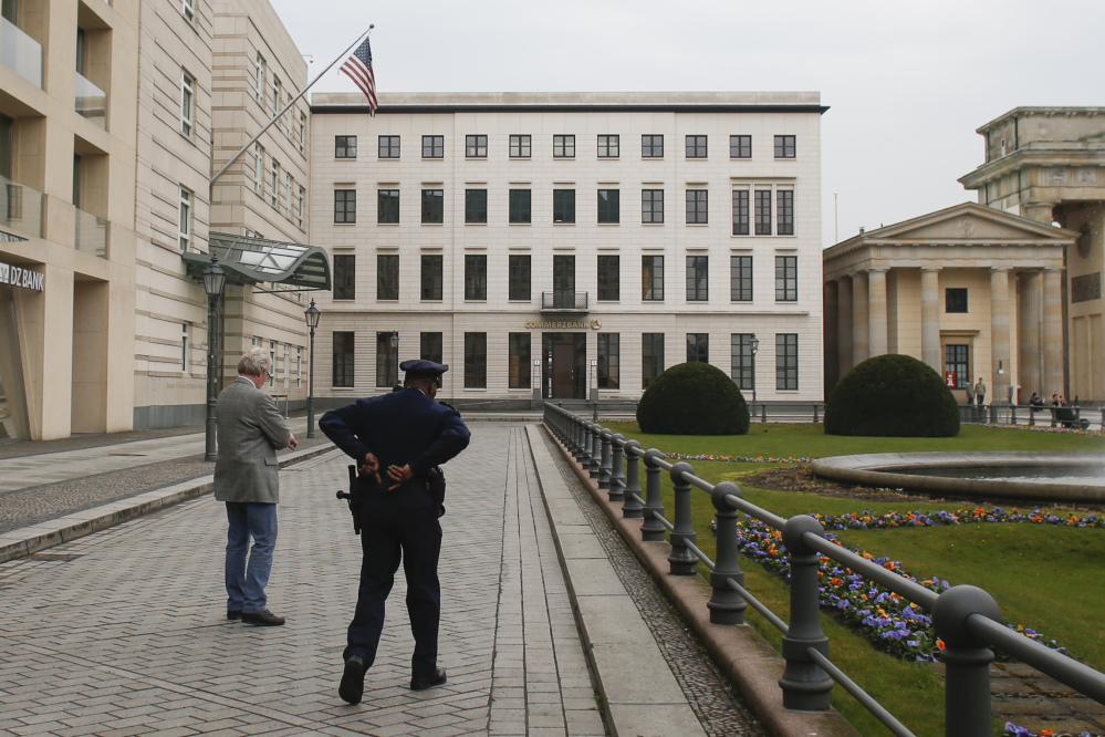 United States security officers patrol in front of the  U.S. embassy in Berlin in this 2013 photo. Germany took the dramatic step Thursday of asking the top U.S. intelligence official in Berlin to leave the country, following two reported cases of suspected U.S. spying and the yearlong spat over eavesdropping by the National Security Agency.
