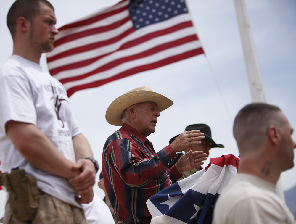 Rancher Cliven Bundy speaks near Bunkerville, Nev., in April. The victory Bundy claimed against the government has emboldened right-wing extremists, a new report says.