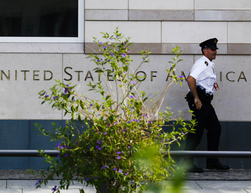A security officer walks outside the U.S. embassy in Berlin. On Thursday, Germany asked the top U.S. intelligence official at the Berlin embassy to leave the country.