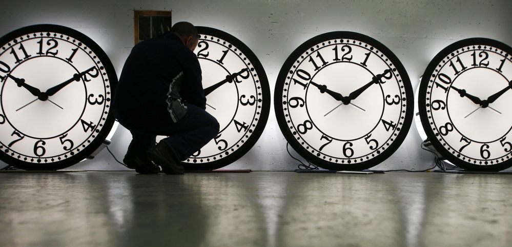 An employee at a clock factory in Medford, Mass., adjusts some of his company's clocks to account for daylight-saving time last year. Utah is the latest state to consider doing away with daylight-saving time.