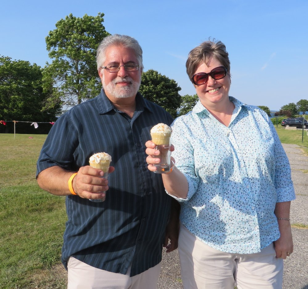 Drew and Cheryl Poulopoulos of Old Orchard Beach, using souvenir glasses as cupcake holders, toast Share Our Strength at Fort Williams Park in Cape Elizabeth. Photo by Amy Paradysz
