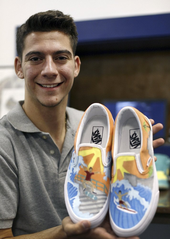 Christian Fuda, 17, of Hull, Mass., displays some of the custom-painted footwear he creates and sells.