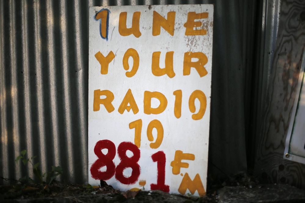 A sign reminds customers where to tune their radio to switch on their car radio to pick up the audio at the Saco Drive-In in Saco.