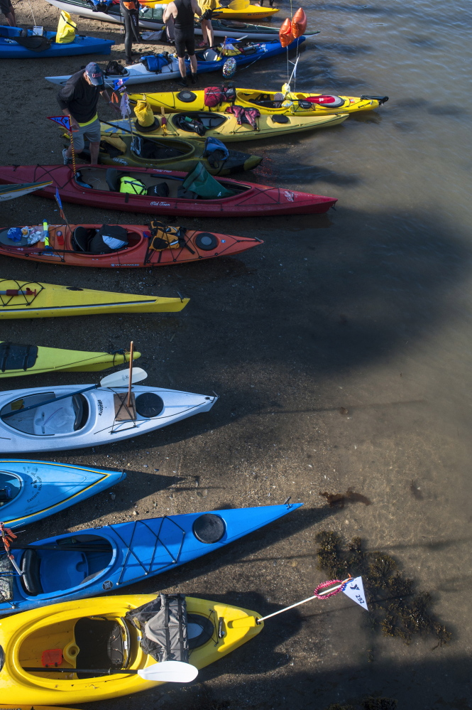 Kayakers prepare on the shore during the Peaks to Portland on Saturday.