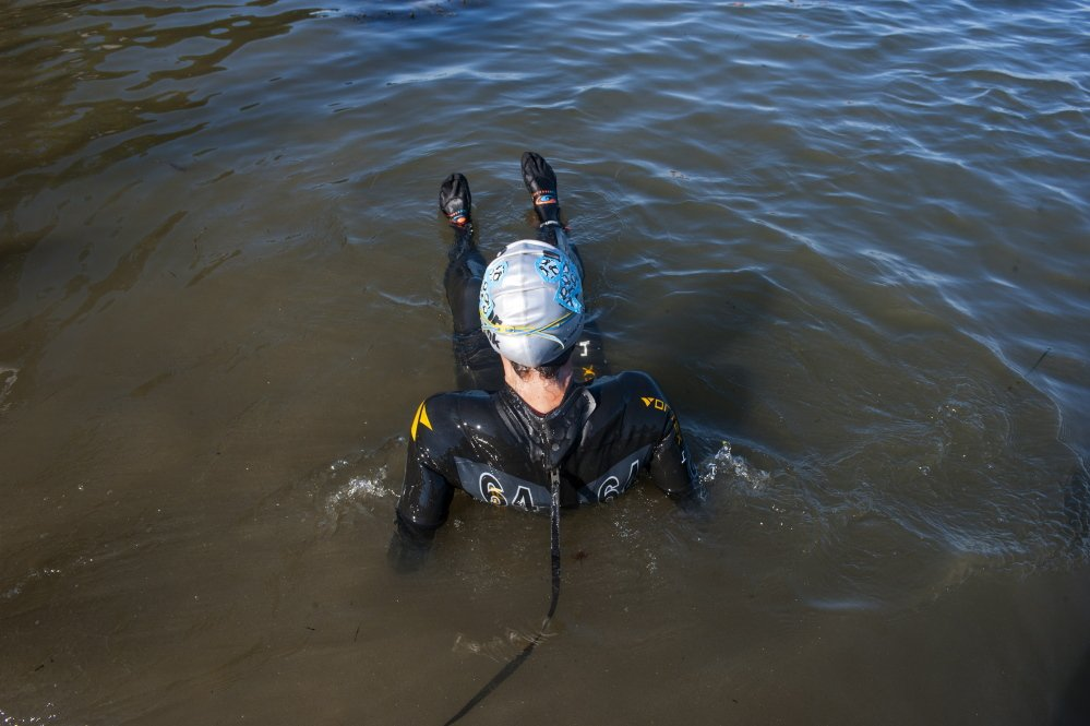 Katie Dwyer loosens up in the water before the Peaks to Portland on Saturday.