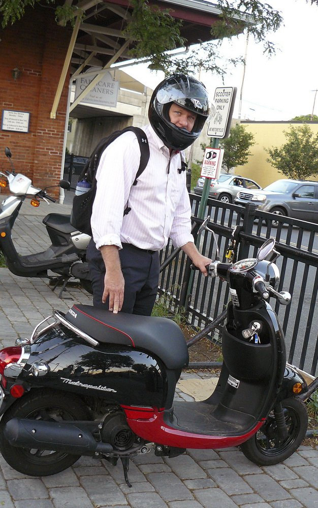 Zach Chapman prepares to jump on his scooter for his daily ride home from the Fairfield Center train station in Fairfield, Conn. Chapman became a scooter commuter because he said that riding his scooter is better for the environment than driving a car.