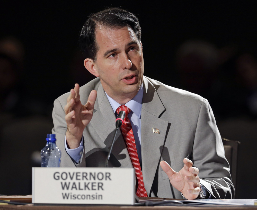 Wisconsin Gov. Scott Walker speaks at the National Governors Association convention on Saturday in Nashville, Tenn. He is trying to strike a balance on same-sex marriage.