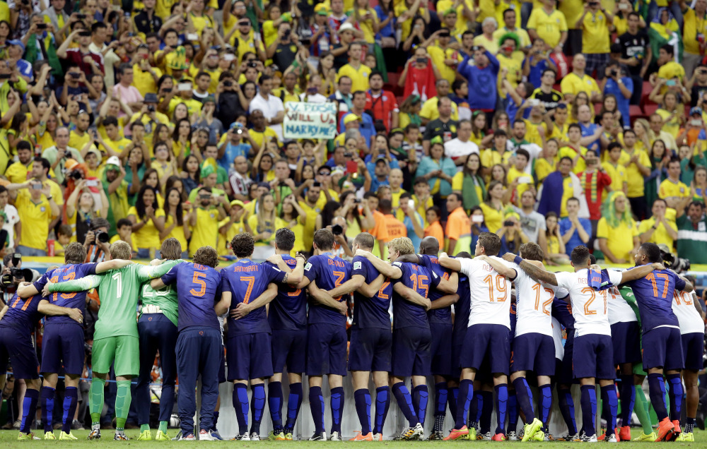 The Dutch team line up for a photo after the World Cup third-place soccer match between Brazil and the Netherlands at the Estadio Nacional in Brasilia, Brazil, Saturday.