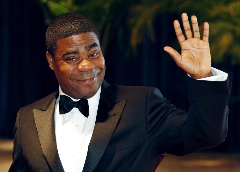 Comedian Tracy Morgan is suing Wal-Mart after a driver of one of its trucks slammed into his limo van on June 7. Morgan, shown in 2010, is still recovering from a traumatic brain injury he suffered, his lawyer says.
