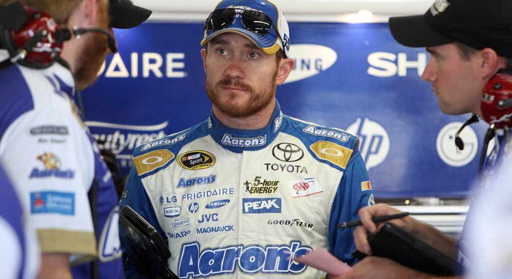 Brian Vickers, who has had heart surgery to prevent blood clots, talks with his crew after the Saturday morning practice for Sunday's Sprint Cup Series at New Hampshire Motor Speedway in Loudon, N.H.