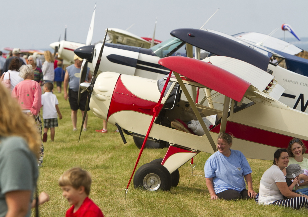 People gather at Sprague Field in Cape Elizabeth for the fly-in on Sunday.