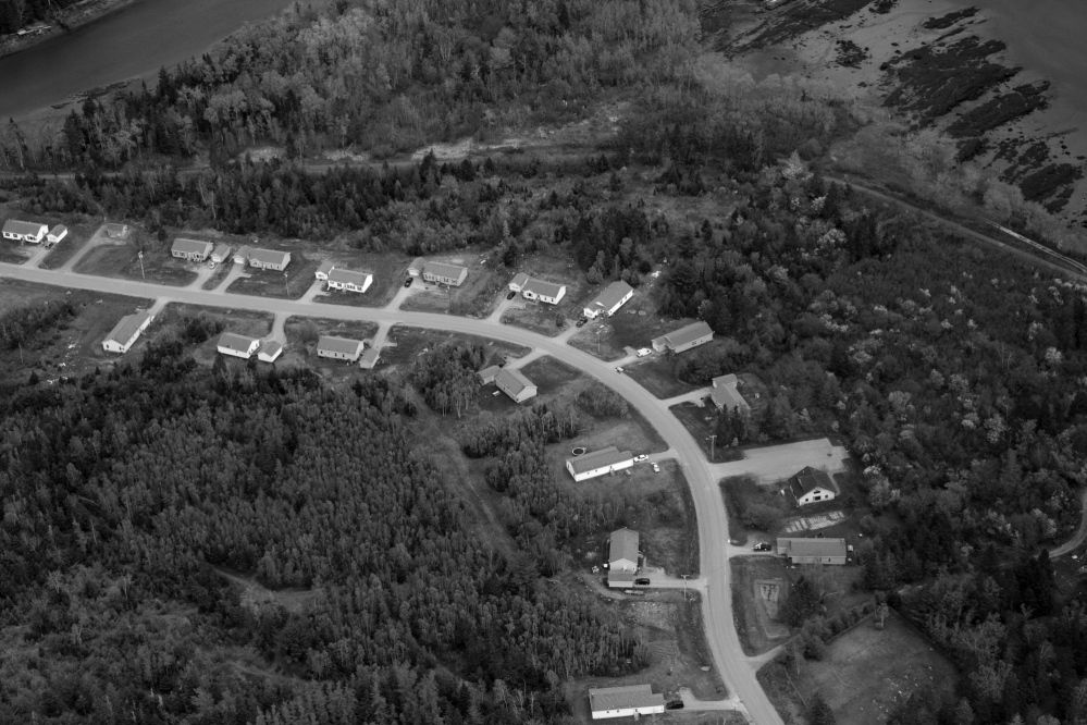 Federally funded homes line a stretch of road on the Pleasant Point reservation in eastern Maine. At the time of the historic Passamaquoddy v. Morton court case, tribe members on the reservation had a per capita income of $700, compared to $2,069 for residents of Washington County, the state's poorest.