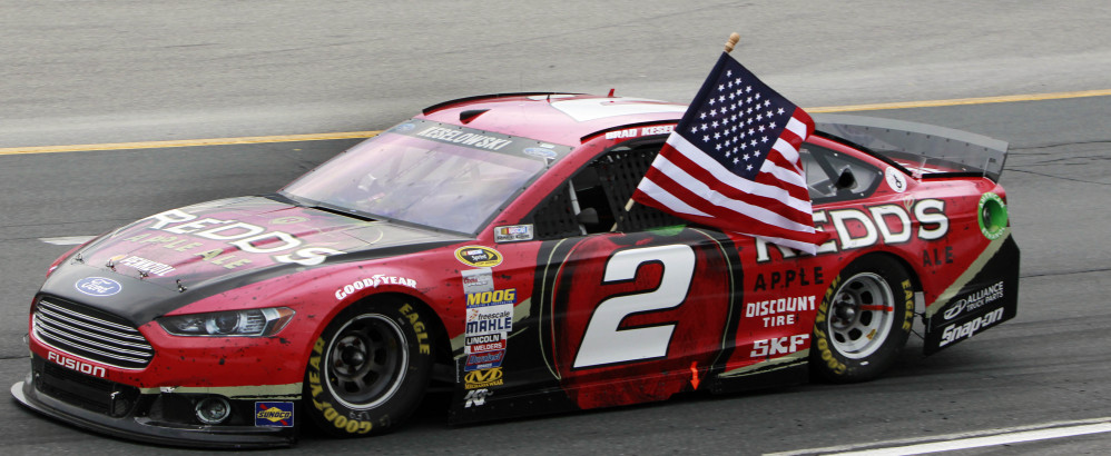 Brad Keselowski celebrates after winning the NASCAR Sprint Cup Series auto race at New Hampshire Motor Speedway on Sunday in Loudon, N.H. The Associated Press