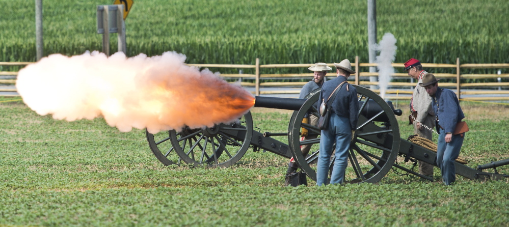Civil War re-enactors fire an artillery blast at the Monocacy National Battlefield near Fredrick, Md., last week. Keene State College students are transcribing 144 letters written by Pvt. Willard Templeton as he traveled and fought with the 11th New Hampshire Regiment.