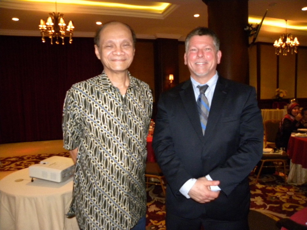 Kennebec Valley Community College President Richard Hopper, right, appears with his former colleague, Pak Bagyo Moeliodihardjo, an Indonesian education official, during a recent trip to Indonesia.