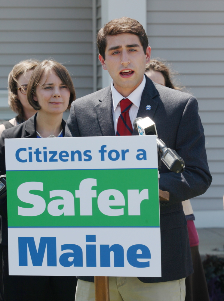David Boyer, Maine political director of the Marijuana Policy Project, speaks at a news conference Monday outside of South Portland City Hall. At his left is Democratic U.S. Senate candidate Shenna Bellows.  Joel Page/Staff Photographer