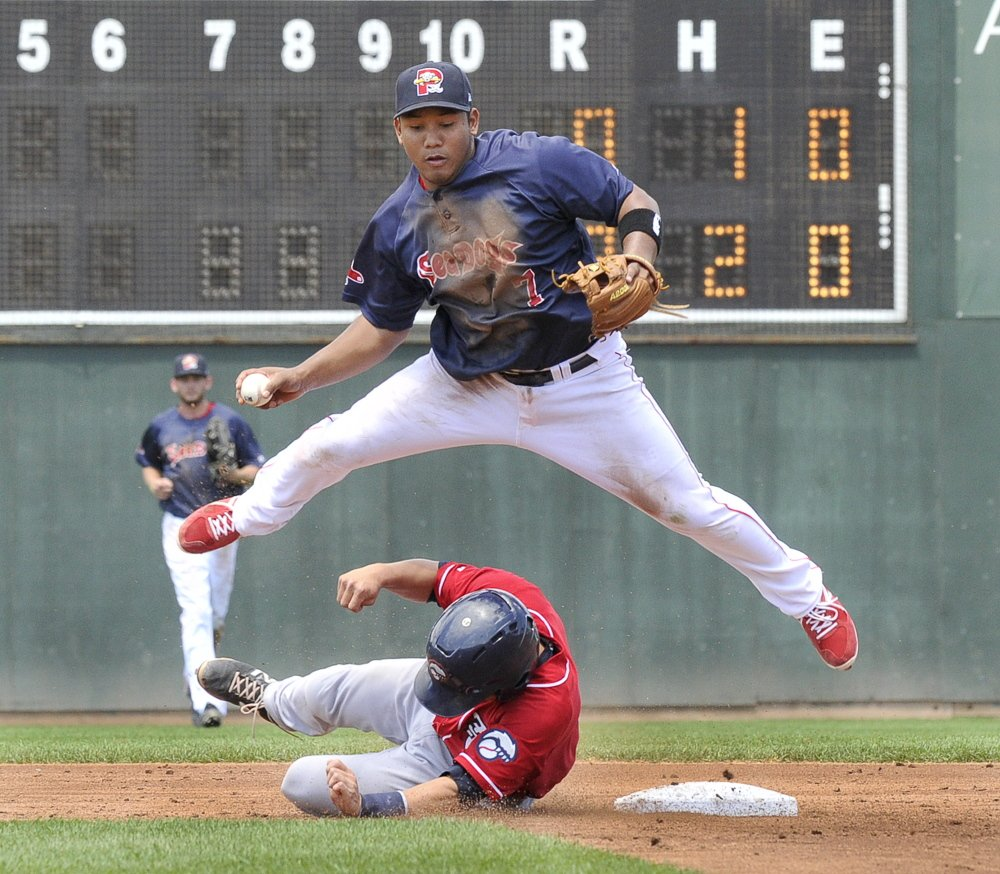 Portland's  Heiker Meneses is taken out of a double play as Fisher Cats Derrick Chung slides wide of second at Hadlock Field in Portland. John Patriquin/Staff Photographer