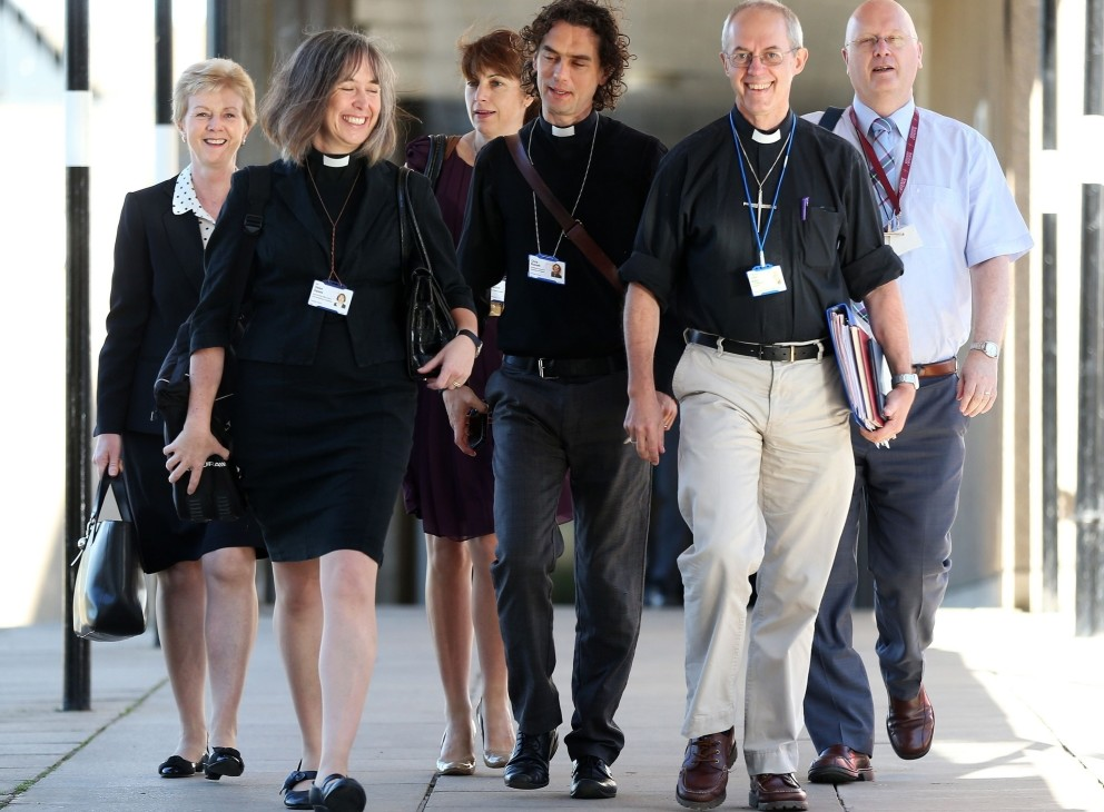 The Archbishop of Canterbury, Justin Welby, second from right, and unidentified members of the clergy arrive for the General Synod meeting at The University of York, in York, England, on Monday.