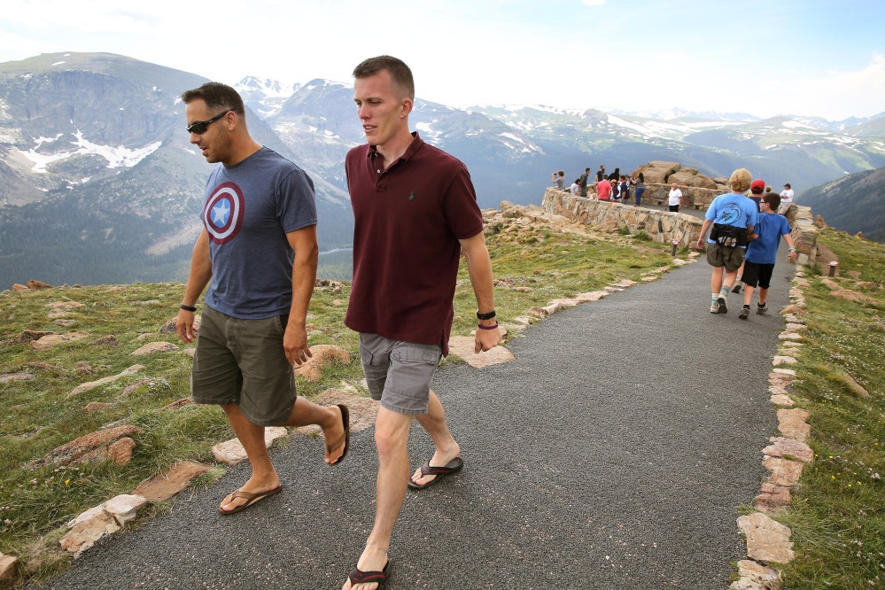 Visitors walk a short trail at a scenic overlook off Trail Ridge Road at Rocky Mountain National Park, west of Estes Park, Colo., on Monday. Lightning killed two people last weekend just miles apart in the popular park, where summer storms can close in quickly with deadly results.