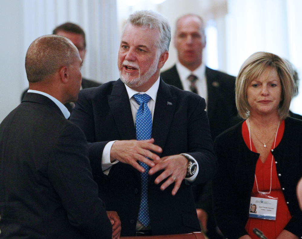 Premier Philippe Couillard of Quebec speaks with Massachusetts Gov. Deval Patrick at the New England Governors and Eastern Canadian Premiers 38th annual conference Monday in Bretton Woods, N.H.